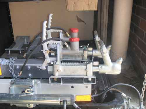 hydraulic override bracket